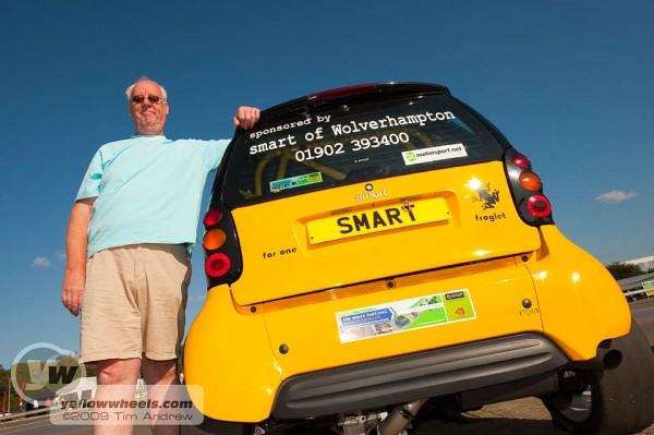 Jim Casey poses with his hillclimb Smart